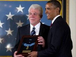 Ray Kapaun accepts his uncle's Medal of Honor from Pres. Obama
