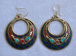 Moon shape ear ring made of german silver used with lapis, turquoise and coral each piece handcrafted by women artisans. elegant wearing, oriental look and high in fashion