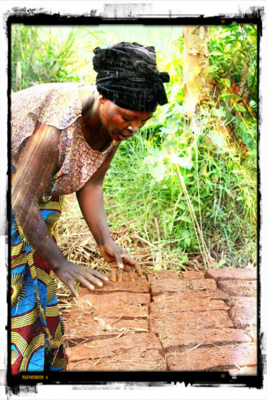Woman making bricks