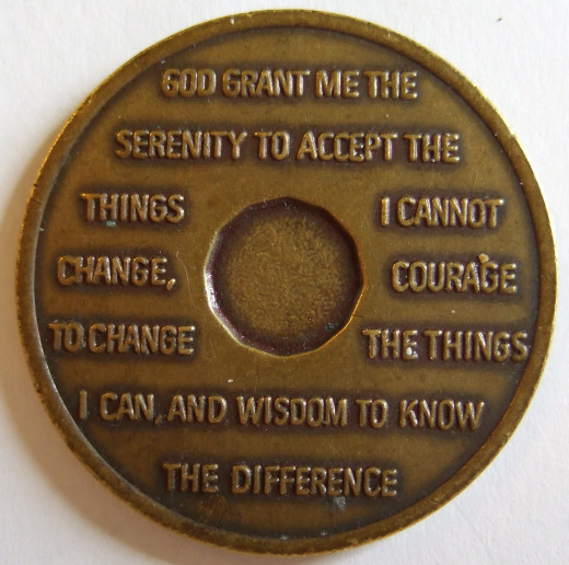A coin showing the Serenity Prayer, by Reinhold Neibuhr.
