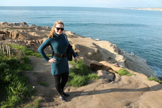 Photo of me wearing a simple cashmere sweater dress in La Jolla, CA.
