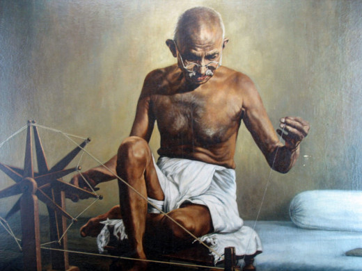 Mahatma Gandhi with his Charkha