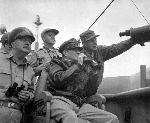 General Douglas MacArthur (left), commander of the UN forces watching the bombardment of Incheon from the USS Mt. McKinley