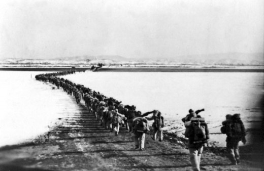 Chinese troops crossing the Yalu River to join the war on the side of North Korea in early 1951.