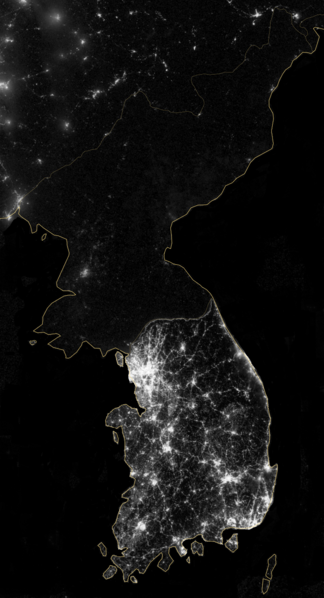 A satellite image of the Korean Peninsula at night, while prosperous South Korea is lit up like a Christmas tree. The North is shrouded in darkness.