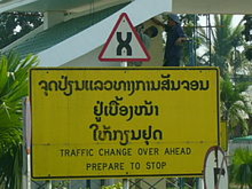 Thai Words on a Warning Road Sign
