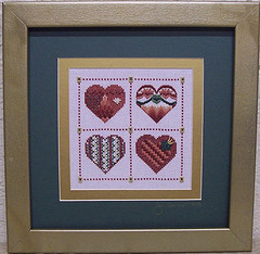 This cross stitch is double matted.