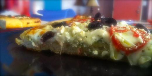 Mediterranean style pizza on sourdough crust