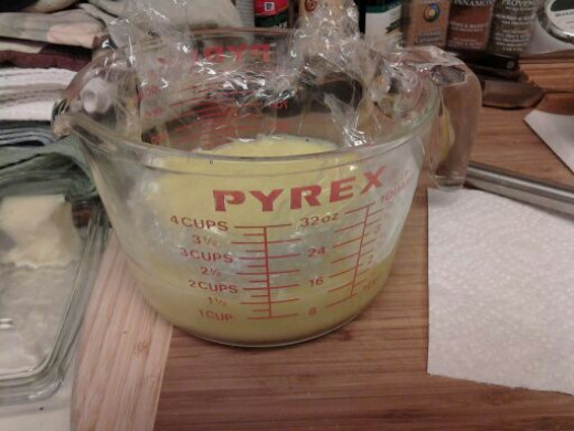 Covering the custard with plastic wrap