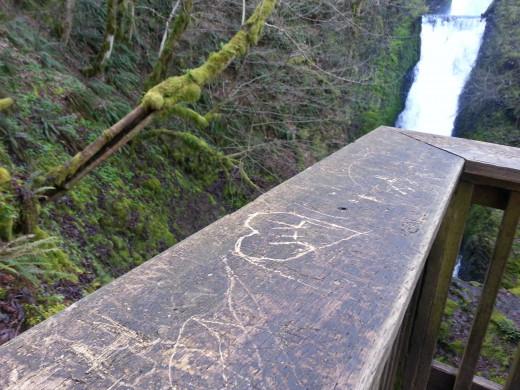 Lovers carved their names in wood below the Bridal Veil Falls.