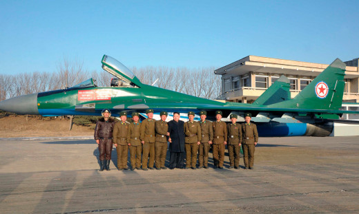 A North Korean MiG-29 Fulcrum. Kim Jong-Un stands at center