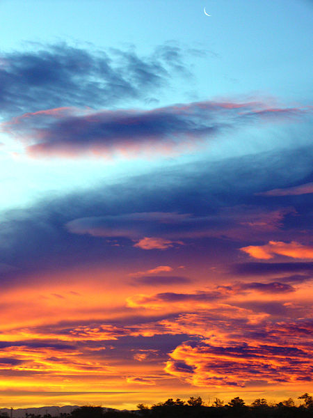 Moon in sunrise sky. Author: Jessie Eastland aka Robert DeMeo