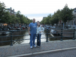 Traveling together can strengthen a married couple's bond and renew romance. (Pictured: My husband and I in Amsterdam, strolling down the canals.)