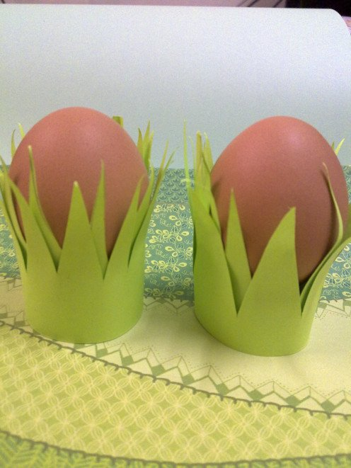 Give the eggs some cozy grass cups