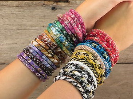 Nepali glass bead roll over bracelet are available in different colors like red, green, blue, yellow. You can also get it in sparkling shades like rose, aqua and magneta