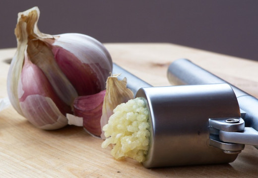 Garlic crushed using a garlic press, ready for use is ideal for use in health enhancing remedies.