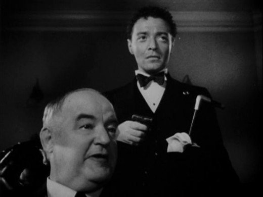 Gutman and Cairo confront Sam Spade.
