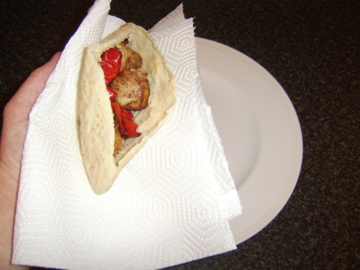 Chicken and vegetables are carefully stuffed in to pitta bread