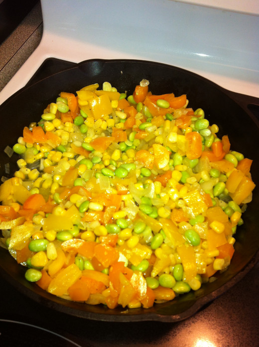 Then add the frozen corn and frozen edamame.