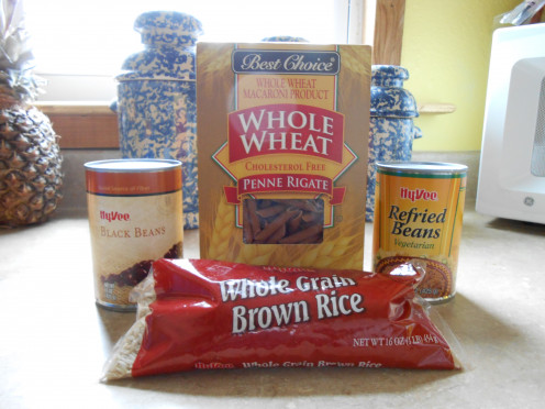 Beans are legumes.  Brown rice and whole wheat pasta are examples of wholegrain foods.