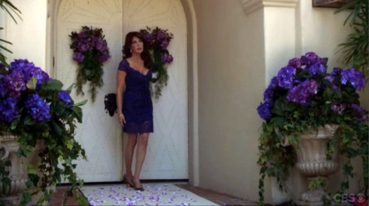 Taylor admires the Forrester Estate courtyard decked out in blue flowers for Liam and Steffy's Wedding