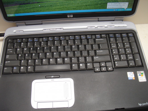 Keyboard space bar has solder burn mark.