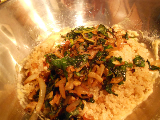 Add Quinoa and spinach/onion mixture to egg mixture and combine with a spoon
