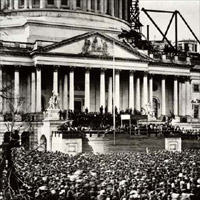 Many gathered at the East Portico of the unfinished Capitol to see Lincoln's first Inauguration.