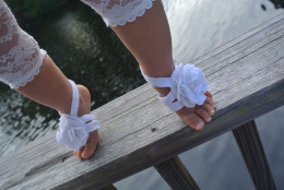 I reused another old shirt and some old pearl beads for these footless baby sandals.