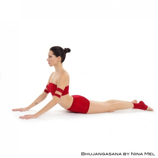 Cobra pose or bhujangasana helps to strengthen the spine and arms.