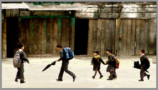 A group of kids on their way to or from school. Some of these students may struggle with learning disabilities.