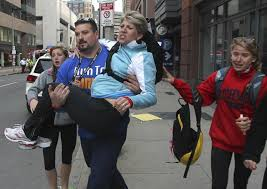 Former New England Patriot player Joe Andruzzi, after hearing the blasts, leaving his nearby home and  helping a woman to safety.