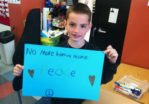 Martin Richard was killed in the Boston Marathon terror attack.  Here, he is shown in his classroom last April after the shooting of Trayvon Martin.