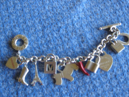 This charm bracelet and charms are from Tiffany. A word of caution, they are often reproduced