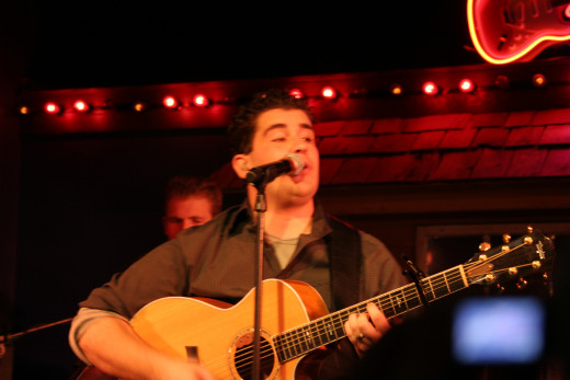 Josh Gracin sings and plays the guitar during a concert for the US Marine Corp.