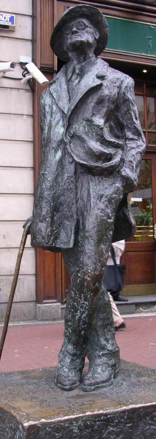Photo by Toniher: James Joyce statue on North Earl Street near its junction with O'Connell Street in Dublin, by Marjorie FitzGibbon. CC-BY-SA 2.5.