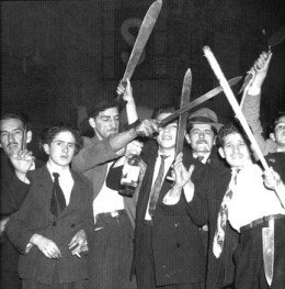 A mob of liberals gather with machetes on the streets