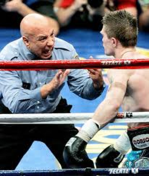 Referee Joe Cortez counts over Ricky Hatton after the boxer was felled by Floyd Mayweather.