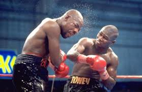 James Toney shown landing a counter right hand on Iran Barkley won the Super Middleweight title in this bout.