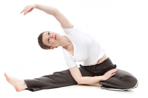 Relief premenstrual symptoms with stretching exercises.