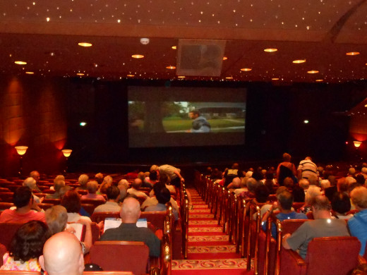 """The movie screen in the Princess Theater, where passengers watched, """"Silver Linings Playbook,"""" and also where the Broadway type entertainment took place."""