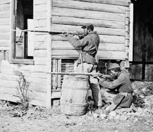 Two soldiers taking careful aim, this picture looks somewhat staged, but could be rel.