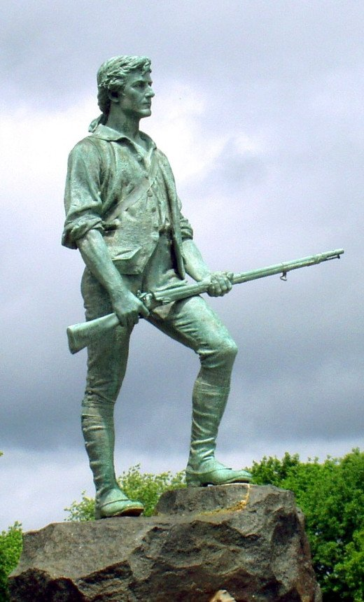 "Commonly called the ""Lexington Minute Man,"" this is a statue of Captain John Parker sculpted by Henry Hudson Kitson. It was erected on the Battle Green in Lexington, MA in 1900."
