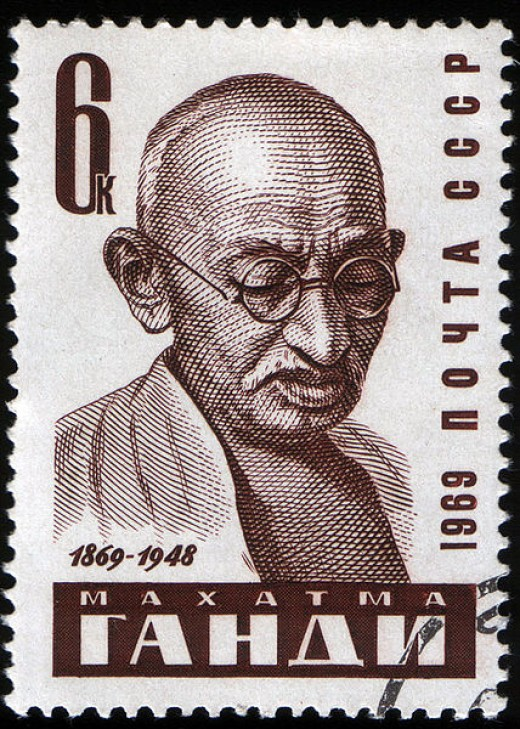 Did Gandhi write a report on the Olympics while in jail?