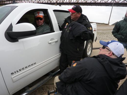 Bill Dance, George Young Jr. and Jonathon Herndon, the host of Maximum Catfishing, chatting on the ramp at Mudd Island.