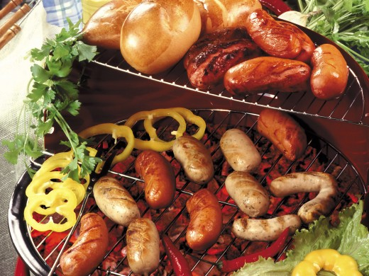 Meats on the grill with vegetables.