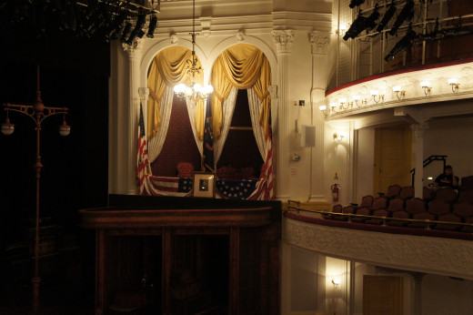 Lincoln was sitting to the right in a rocking chair when he was assassinated