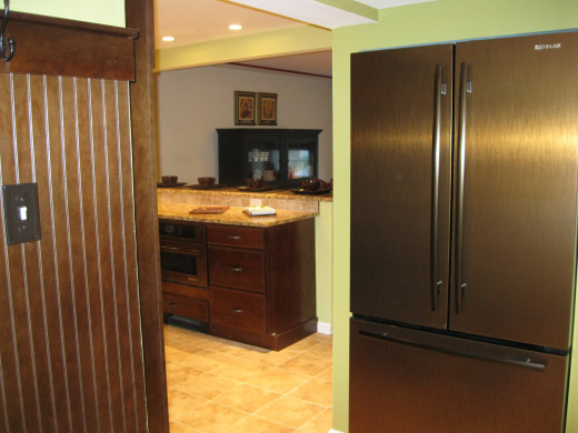 Oiled-brushed bronze Jenn Air refrigerator and built-in microwave