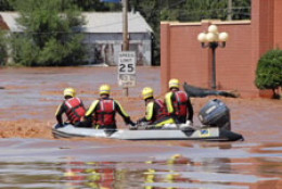 Rescuers Boat Through Flooded Streets