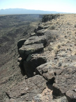 The rim of the Rio Grande Gorge is lined with volcanic rocks